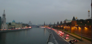 Moscow River on the left, Kremlin on the right, with a small taste of Moscow traffic weaving in between.